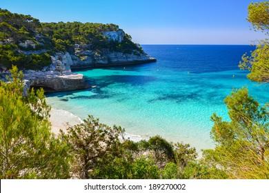 Secluded beach with turquoise sea water, Cala Mitjaneta, Menorca island, Spain