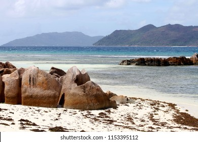 Secluded beach with withe sand, photogenic granite rocks and clear waters in the Praslin island, Seychelles