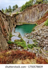 secluded blue lake in a quarry in  wales
