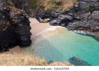 Secluded English cove with beautiful turquoise sea and sand beach