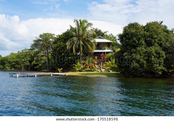 Secluded house with dock and garden on an tropical island, Caribbean sea, Panama