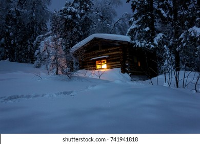 A secluded hut deep in the winter forest.