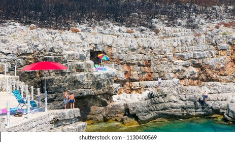 Secluded rocky beach of adriatic coast which suffered wildfires, Montenegro
