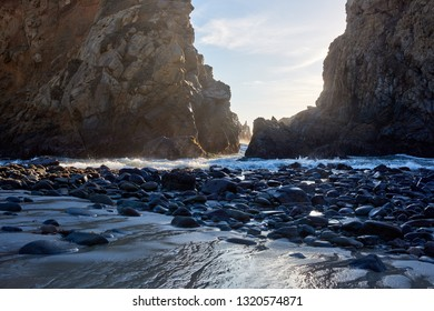 Secluded, sandy, rocky California beach and waves