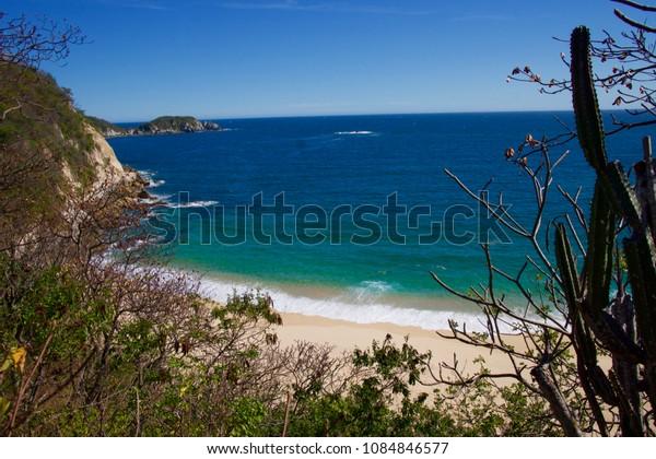 secluded white sand beach Oaxaca Mexico