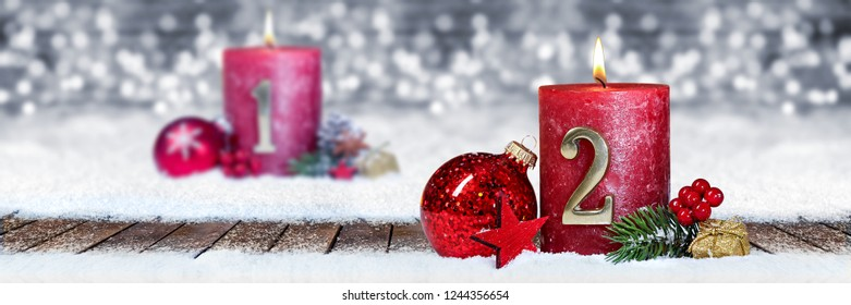 Second advent snow panorama candle with number decorated christmas Advent Season wood background lights bokeh / second sunday advent