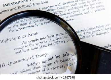 The second amendment to the constitution of the United States is shown under a magnifying glass.