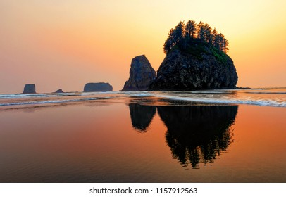 Second Beach sunset threw forest fire smoke in La Push, Washington state, Olympic coast.
