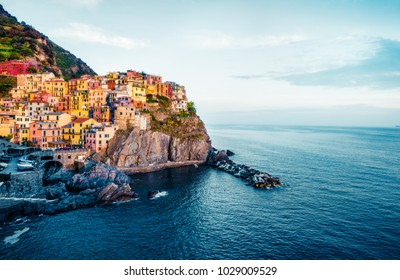 Second city of the Cique Terre sequence of hill cities - Manarola. Colorful spring morning in Liguria, Italy, Europe. Picturesqie seascape of Mediterranean sea. Instagram filter toned.