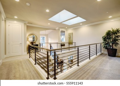 Second floor landing features skylight over the staircase with metal horizontal railings. Northwest, USA