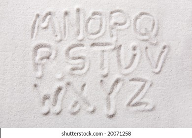 Second half of an upper case alphabet written in sand - a designers tool