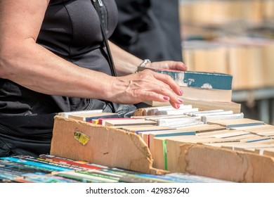 Second Hand Book Stall. Woman Buying Books