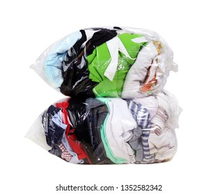 second hand clothes in the plastic bag isolated white background, clothes in bags plastic for donation, pile of dirty clothes, old cloth in plastic bag, clothes second hand for donate, clipping path