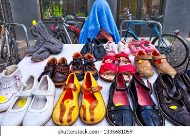 Second hand footwear at temporary marketplace in town.