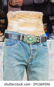 Second hand jeans and model at footpath, Background of fashion jeans.