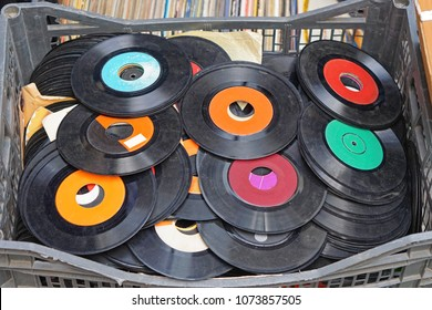 Second hand vinyl records in basket at flea market