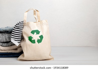 Second hand wardrobe idea. Circular fashion, eco friendly sustainable shopping, thrifting shop concept. Woman outfit.