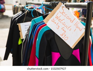 Second hand wetsuits starting from only £10 pounds on sale rack preowned so surfers swimmers bodyboards can all go into the cold sea and stay warm. Great for doing waterspouts in England