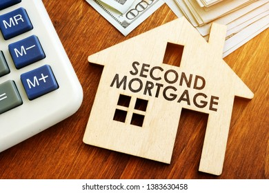 Second Mortgage written on wooden home.