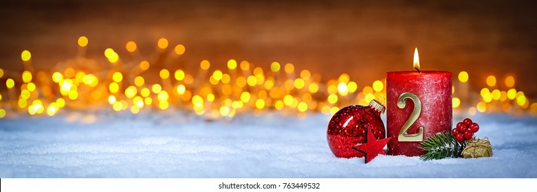 second sunday in advent concept xmas light wooden wide panorama background with candles ball bauble stars