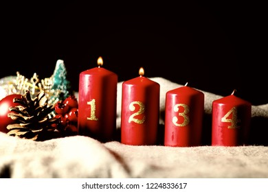 Second Sunday (week) of Advent - four Advent candles (with two burning) and Christmas decoration