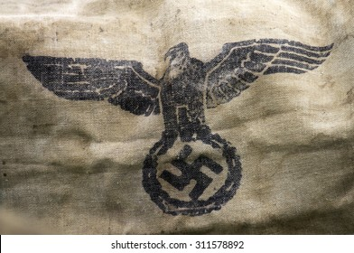 A second world war hessian bag, stamped with the Nazi Party eagle-and-swastika emblem.