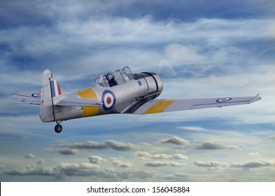Second World War T6 Harvard Airplane flying into the sky