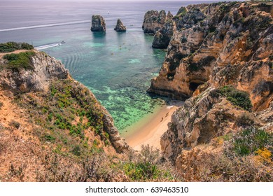 Secret beach in Lagos, Algarve surrounded by cliffs