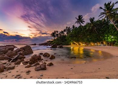 Secret Beach in Mirissa. A tropical paradise where the jungle meets the sea.