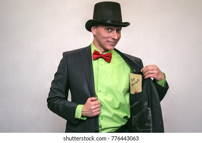 Secret detective agent in suit and hat holds in hand secret compromising evidence letter isolated on white. Secret service.