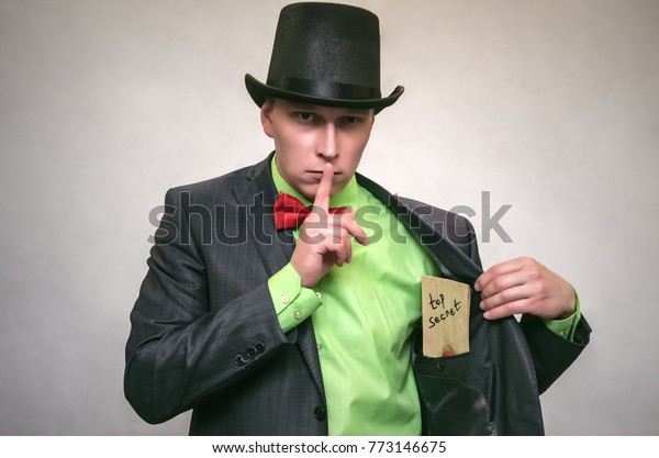 Secret documents letter with compromising evidence in hands of secret detective agent isolated on white. Secret service. The spy concept.