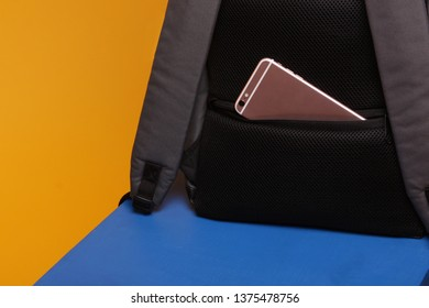 Secret safe pocket on the back of the backpack for the phone from thieves. Storage concept of things in a safe place while traveling in public transport. Anti-theft