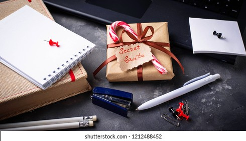 Secret Santa surprises. Christmas celebration in the office