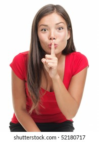 Secret woman. Asian woman saying hush be quiet. Beautiful mixed race caucasian / chinese young woman isolated on white background.
