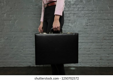 secretary is holding a briefcase