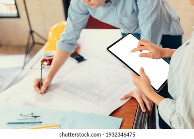secretary, industry manager, engineer, businessman reading and checking blueprint, drawing plan on tablet between meeting.
