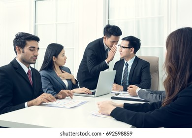 Secretary inform bad news to boss and businesswoman hear about it so she touch her chest because she was frightened and stunned with fear during the meeting at office. Sadness and depression concept.