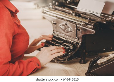 Secretary at old typewriter with telephone. Young woman using typewriter. Business concepts. Retro picture style. typewriter, typist