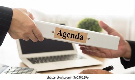 Secretary sends files agenda to the manager. selective focus.
