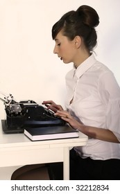 secretary working with vintage typewriter
