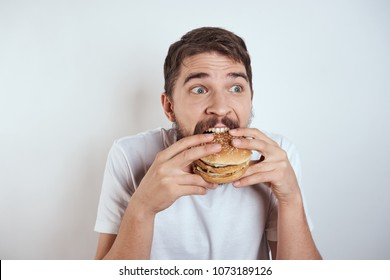 secretive man eating a hamburger, emotions