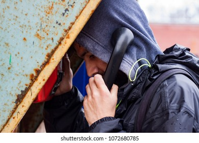 secretive person speaks by payphone