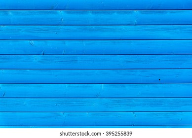 Section of blue wood panelling from a seaside beach hut. Perfect as a background for Summer Holiday or seaside themes.