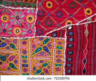 Section of an intricately detailed and colorful, Indian Wall Tapestry in closeup, for sale at a shop in Jaisalmer, Rajasthan, India.