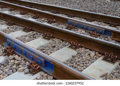 Section of railway track showing the fastenings, sleepers and ballast