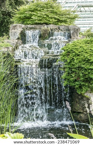 Section Of The Rock Garden With Waterfall In Kew Botanical Garden.  Richmond, London,