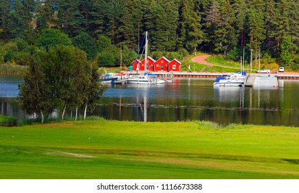 Section of sea harbour in Kastelholm in Aland Islands, Finland. ( In foreground a part of golf ground).