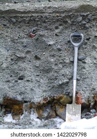 Section through a granular ice debris flow deposit from Ruapehu, New Zealand. Grey volcanic ash colours the deposit. Small stones show slight reverse grading. A second, small deposit is at top.