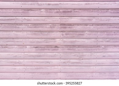 Section of weathered pink wood panelling from a seaside beach hut. Perfect as a background for Summer Holiday or seaside themes.