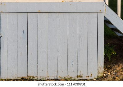 Section of white wood panelling from a seaside beach hut. Perfect as a background for Summer Holiday or seaside themes.